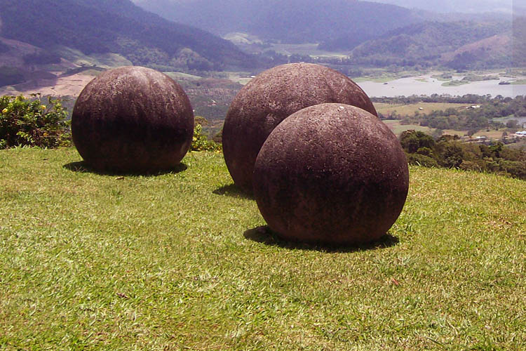 Stone spheres of Costa Rica on hillside overlooking the Reventazon river.